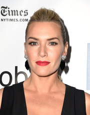 Kate Winslet swept her hair back into a ponytail with a teased top for the New York Film Festival premiere of 'Steve Jobs.'