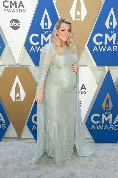 Gabby Barrett looked regal in a caped sage-green maternity gown by Talbot Runhof at the 2020 CMA Awards.