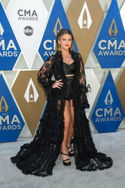 Maren Morris looked sensual in a sheer black lace gown layered over a bustier and hot pants at the 2020 CMA Awards.