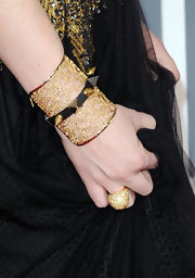 Shawna Thompson's spiked cuff bracelet was a fierce-looking contrast to her elegant evening dress at the Grammys.
