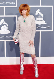 Linda Ramone accessorized her red carpet ensemble with daring silver knee-high boots.