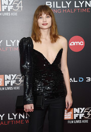 Makenzie Leigh teamed a black patent clutch with an asymmetrical sequin top and a pair of pants for the New York Film Festival screening of 'Billy Lynn's Long Halftime Walk.'