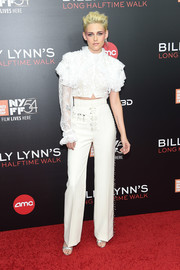 Kristen Stewart went flamboyant in an asymmetrical white ruffle blouse by Rodarte at the New York Film Festival screening of 'Billy Lynn's Long Halftime Walk.'