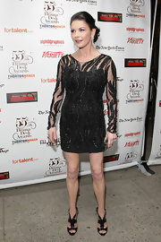 Catherine wore a sequined mini dress with fierce cutout leather Estele sandals.
