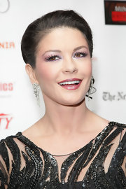 Catherine Zeta Jones paired her classic bun with dangling diamond earrings.