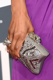 Shaun Robinson added some sparkle to her solid purple gown with a shiny box clutch at the 2013 Grammys.