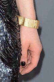 A textured gold bracelet added some warmth to Carly Rae Jepsen's cool blue look at the 2013 Grammys.