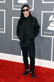 Skrillex stayed true to his unique style with this black bomber jacket, which complemented his all black look.