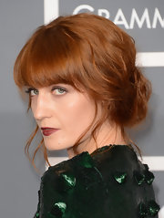 Florence Welch's bright red hair was styled in a slightly messy updo and simply popped against her emerald green gown.