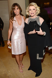 Posing with Mom Joan Rivers at the 55th Annual Grammy Awards Pre-Grammy Gala, Melissa looked sweet and stylish in this baby-pink beaded dress.
