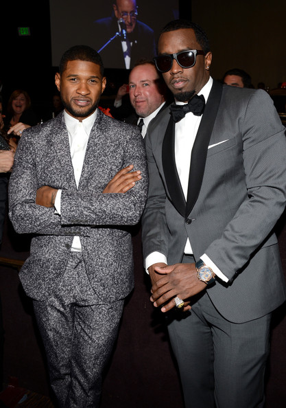 Sean Combs went for classic elegance in a gray tuxedo with black satin lapels at the pre-Grammy gala.