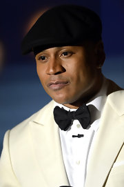 LL Cool J paired a casual newsboy hat with a classic white tuxedo at the 2013 Grammy's Awards.