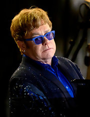 Elton John added his own pizazz to classic Wayfarers with these blue, rhinestone sunglasses.