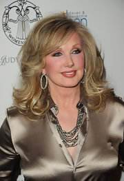 Morgan Fairchild accentuated her lovely face and gorgeous 'do with a pair of diamond hoops.