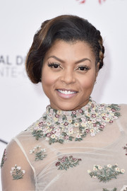 Taraji P. Henson showed off an elaborate updo, consisting of knots, twists, and waves, during day 1 of the Monte Carlo TV Festival.