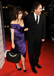 Helena Bonham Carter's pearl-printed black tote was a polished touch to her red carpet look.