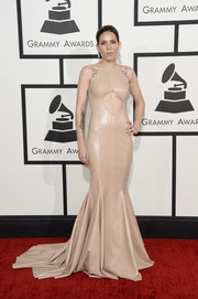 Skylar Grey worked the Grammys red carpet in a nude Michael Costello leather gown with a belly-baring cutout and a mermaid silhouette.