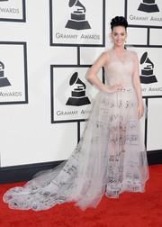Katy Perry donned a delicate nude Valentino Couture gown, aptly printed with musical notes, for the Grammys.