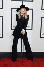 Madonna hit the Grammys red carpet wearing a black Ralph Lauren tuxedo.