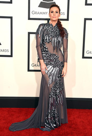 Keltie Knight was futuristic-glam at the Grammys in a sheer gray gown with sequined clusters and fringes.