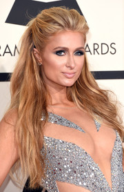 Paris Hilton looked quite the bombshell with her big half-up 'do and revealing outfit at the Grammys.