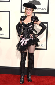 Madonna looked as dynamic as ever in a heavily embellished, corseted mini dress by Givenchy during the Grammys.