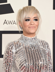Rita Ora wore her hair super short and messy during the Grammys.