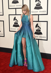 Taylor Swift's magenta Giuseppe Zanotti platform sandals provided a lovely color contrast to her blue dress.