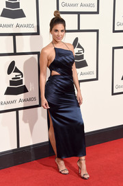 Liz Hernandez looked foxy on the Grammys red carpet in a navy satin dress with a waist cutout and a high side slit.