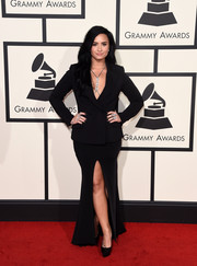 Demi Lovato paired her jacket with a black maxi skirt with a high front slit.