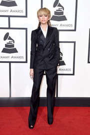 Zendaya Coleman went androgynous in a black pantsuit by Dsquared2 at the Grammys.
