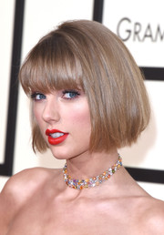 Taylor Swift finished off her look with a multicolored gemstone choker by Lorraine Schwartz.