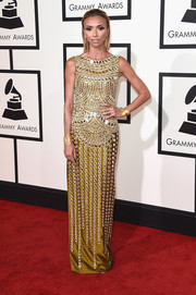 Giuliana Rancic went for exotic glamour in a mirror-embellished gold gown by Jani Khosla during the Grammys.