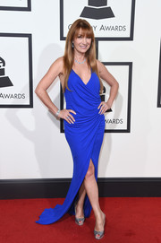 Jane Seymour looked sassy on the Grammys red carpet in an electric-blue wrap dress with a plunging neckline and a high slit.