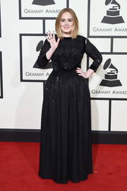 Adele sparkled on the Grammys red carpet in a beaded black gown by Givenchy.