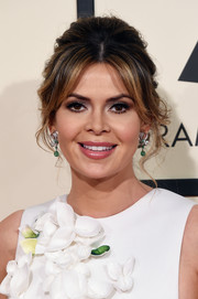 Carly Steel styled her hair into a beehive with center-parted bangs for her Grammys look.