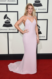 Ellie Goulding opted for a simple pink halter gown by Stella McCartney for her Grammys red carpet look.