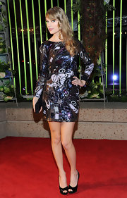 Taylor Swift shimmered in a beaded frock at the BMI Country Awards. Simple black peep-toe pumps completed her look.