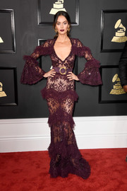 Nicole Trunfio tantalized in a sheer plum lace gown by Zuhair Murad at the 2017 Grammys.