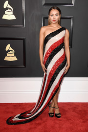 Kat Graham oozed glamour in a sparkly tricolor one-shoulder gown at the 2017 Grammys.