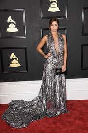 Cassadee Pope made a show-stopping entrance at the Grammys in a flowing silver halter gown with a down-to-the-navel neckline.