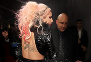 Lady Gaga wore a backless outfit to the 2017 Grammys, showing off a massive moth tattoo.