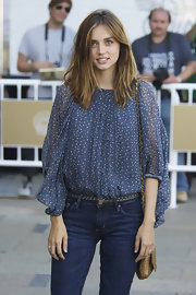 Ana de Armas arrived at the San Sebastian Film Festival in a casual loose blouse tucked into her jeans.
