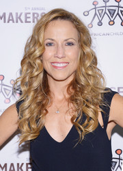 Sheryl Crow went for an ultra-feminine vibe with this long curly 'do at the African Children's Choir Gala.