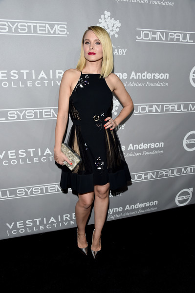 Kristen Bell paired her LBD with a taupe pearlescent box clutch by Edie Parker.