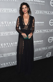 Camila Alves added a spot of color with an emerald-green box clutch by Edie Parker.