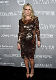 Molly Sims glitzed up her bump in a gold sequin dress for the Baby2Baby Gala.