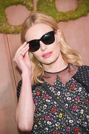 Kate Bosworth styled her look with classic wayfarer shades when she attended the Coach and Friends of the High Line Summer Party.