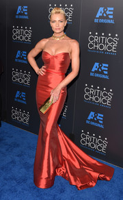 Jaime Pressly flaunted her curves and super-toned arms in a red Gustavo Cadile mermaid gown during the Critics' Choice Television Awards.