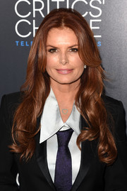 Roma Downey contrasted her mannish outfit with an ultra-feminine wavy 'do when she attended the Critics' Choice Television Awards.